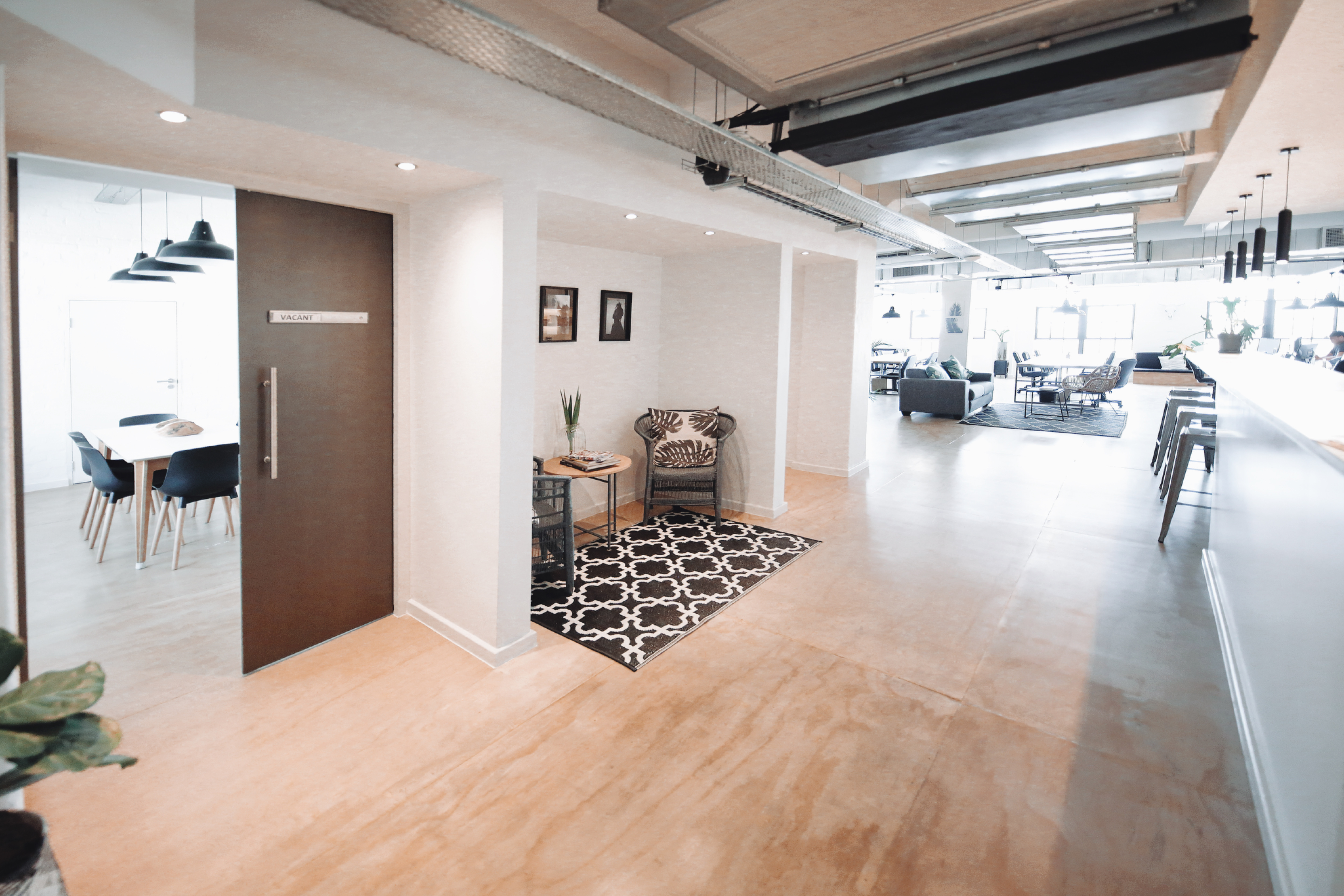 Co-working space entrance hall with reception area.